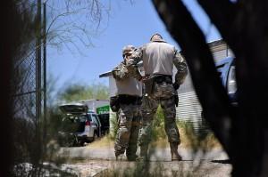 FBI agents conduct a raid