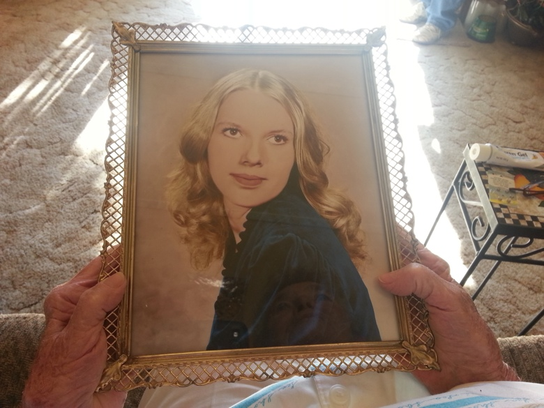 A portrait of Donna Marie Smith held by her mother.